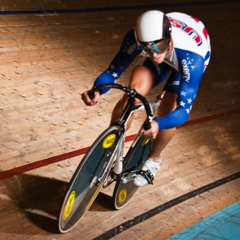 Nate Koch riding his bike on an indoor track