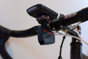Picture of the PowerPod Power Meter on a combo mount with a Garmin Edge 520